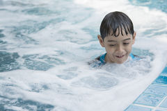 Asian boy swimming on the weekend. Royalty Free Stock Photography