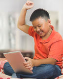 Asian boy with a tablet computer Stock Photo