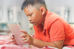 Asian boy with a tablet computer Royalty Free Stock Photo