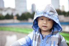 Asian boy taking a wind coat Royalty Free Stock Photos