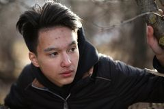 Asian boy teenager in nature Royalty Free Stock Photos