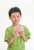 Asian boy thinking with holding Thai money Royalty Free Stock Image