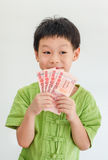 Asian boy thinking with holding Thai money on hand Royalty Free Stock Images