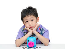 Asian boy thinking what to buy with his savings Stock Photos