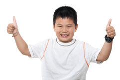 Asian boy thumbs up. Asian boy giving thumbs up, isolated on white background Royalty Free Stock Images