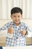 Asian boy thumps up in class Royalty Free Stock Photos