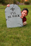Asian boy with tombstone Stock Photo