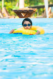 Asian boy in tube learning to swim Royalty Free Stock Image