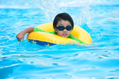Asian boy in tube learning to swim Stock Photography