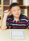 Asian boy upset with his exam result Royalty Free Stock Photography