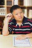 Asian boy upset with his exam result Stock Photo