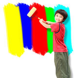 Asian boy use paint roller painting Stock Photo