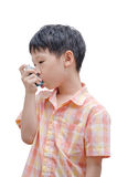 Asian boy using inhaler Stock Photo