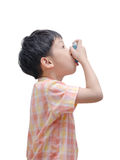Asian boy using inhaler Stock Photos