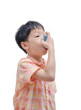 Asian boy using inhaler Stock Image