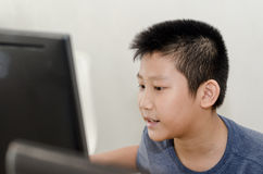 Asian boy using notebook at home Stock Photography