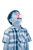 Asian boy using tissue to wipe snot . Child with allergy symptom Stock Images