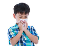 Asian boy using tissue to wipe snot from his nose. Isolated on w. Child blow the nose. Asian boy using tissue to wipe snot from his nose and free form copy space Stock Photos