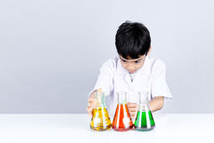 Asian boy is viewing test color combination on science experimen Stock Photography
