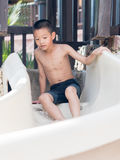 Asian boy waiting to play slider into the pool Stock Images