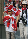 Asian Boy Waving Canadian Flag Stock Photography