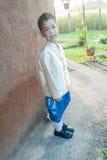 Asian boy wearing national dress. Royalty Free Stock Photography