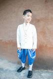 Asian boy wearing national dress. Stock Images