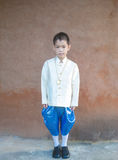 Asian boy wearing national dress. Royalty Free Stock Images