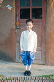 Asian boy wearing national dress. Royalty Free Stock Photo