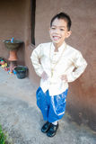Asian boy wearing national dress. Royalty Free Stock Image
