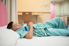 Asian boy wearing Sleep Apnea Diagnostic medical device Kit. Stock Image