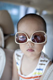 Asian boy wearing sunglass in the car Royalty Free Stock Images