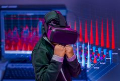 Asian boy, wearing virtual reality glasses on his head, is excited about what he sees. To learn about economy and investment. concept of a boundless world for Royalty Free Stock Images