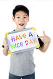 Asian boy with white board with word HAVE A NICE DAY Royalty Free Stock Photography