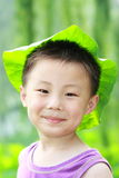Asian Boy With Leaf Cap Stock Photo
