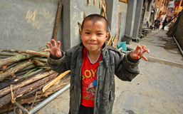 Asian boy 8 years old, playing in street in Chinese countryside. Royalty Free Stock Photo