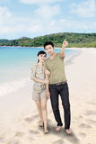 Asian boyfriend pointing at beach Stock Photos