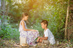 Asian boys and girls Reading a book. In the forest Royalty Free Stock Photo