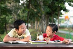 Asian boys laughing each other having fun time together at park in the evening stock photography