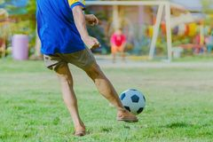 Asian boys practice kicking the ball to score goals royalty free stock images