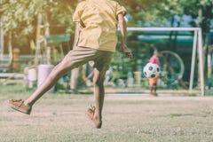 Asian boys practice kicking the ball to score goals royalty free stock photos