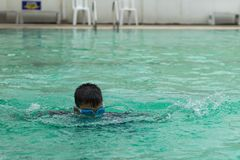 Asian boys are swimming in the pool. Asian boys are swimming in the pool , Thailand stock images