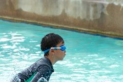 Asian boys are swimming in the pool. Asian boys are swimming in the pool , Thailand stock photography