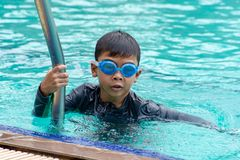 Asian boys are swimming in the pool. Asian boys are swimming in the pool , Thailand stock photos