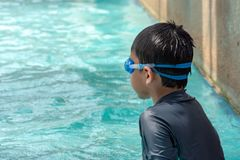 Asian boys are swimming in the pool. Asian boys are swimming in the pool , Thailand royalty free stock photography