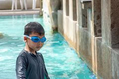 Asian boys are swimming in the pool. Asian boys are swimming in the pool , Thailand stock photo