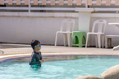 Asian boys are swimming in the pool. Asian boys are swimming in the pool , Thailand royalty free stock photo