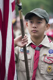 Asian boyscout display US Flag at solemn 2014 Memorial Day Event, Los Angeles National Cemetery, California, USA Royalty Free Stock Photography