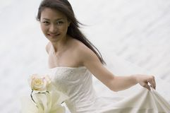 Asian Bride 19. A beautiful young asian woman in a wedding dress. Shot with a lake in the background Stock Photos