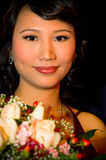 Asian bride. With flower bouquet Royalty Free Stock Photos